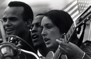 Belafonte, Leon Bibb, and Joan Baez sing on the capital steps in  Montgomery (photo by Matt Herron)